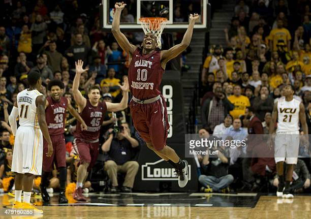 Guard Langston Galloway forward Deandre' Bembry and forward Halil Kanacevic of the Saint Joseph's Hawks celebrate their win over the VCU Rams in the...