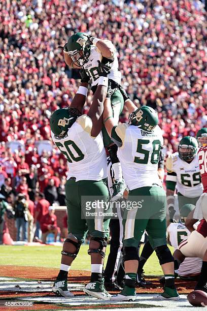 Guard LaQuan McGowan, offensive tackle Spencer Drango and running back Devin Chafin of the Baylor Bears celebrate a touchdown against the Oklahoma...