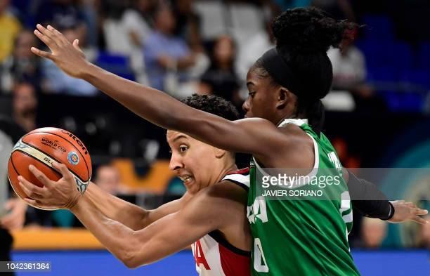 Guard Layshia Clarendon vies with Nigeria's guard Promise Amukamara during the FIBA 2018 Women's Basketball World Cup quarter final match between...