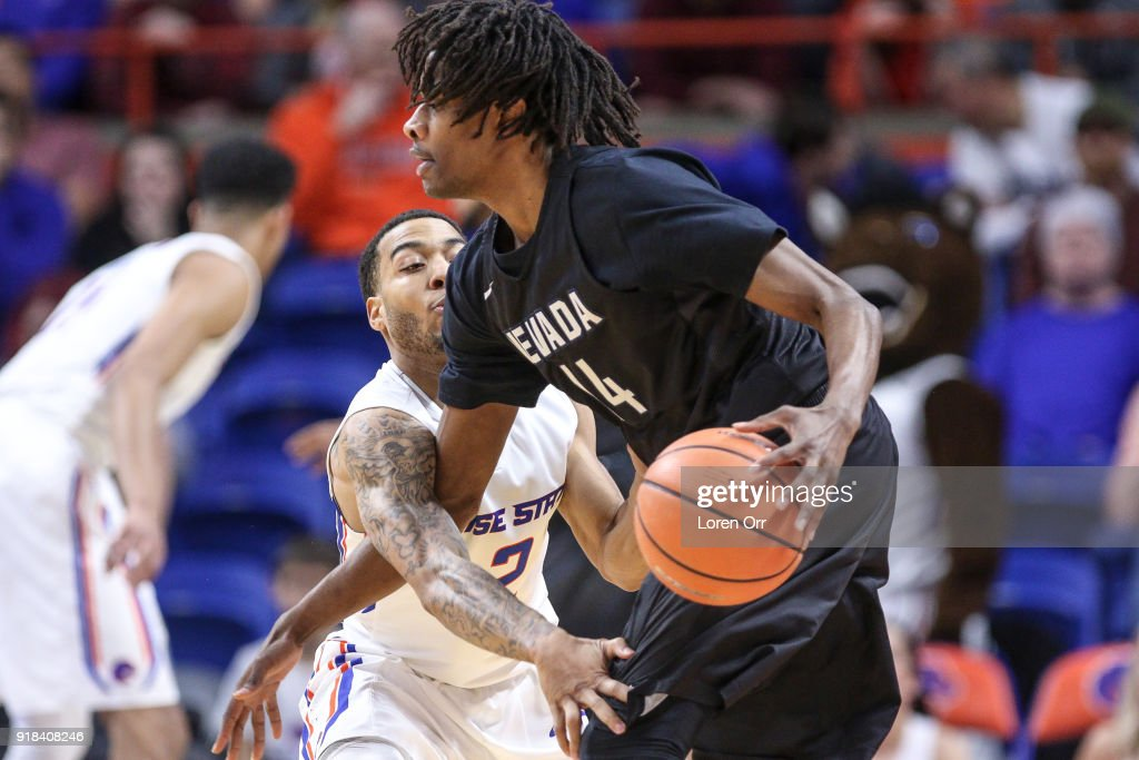 Guard Lexus Williams #2 of the Boise State Broncos tries to steal the ball from guard Lindsey Drew #14 of the Nevada Wolf Pack during first-half action on February 14, 2018 at Taco Bell Arena in Boise, Idaho.