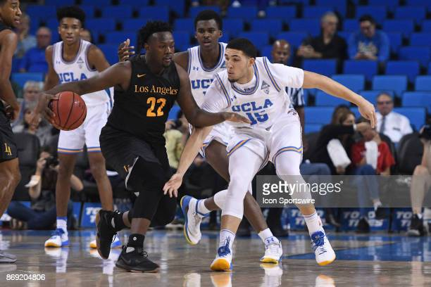 UCLA guard LiAngelo Ball tires to steal the ball from Cal State LA guard Sequan Walker during an college exhibition basketball game between the Cal...