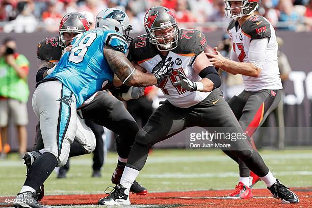 September 7: Guard Logan Mankins of the Tampa Bay Buccaneers blocks Defensive Tackle Star Lotulelei of the Carolina Panthers at Raymond James Stadium...