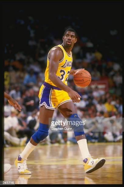 Guard Magic Johnson of the Los Angeles Lakers dribbles the ball during a game at the Great Western Forum in Inglewood California Mandatory Credit...