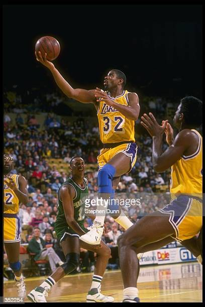 Guard Magic Johnson of the Los Angeles Lakers goes up for two during a game versus the Dallas Mavericks at the Great Western Forum in Inglewood...