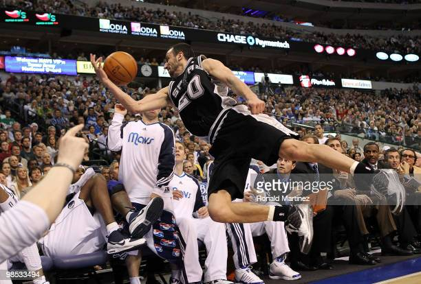 Guard Manu Ginobili of the San Antonio Spurs makes a diving save into the Dallas Mavericks bench in Game One of the Western Conference Quarterfinals...
