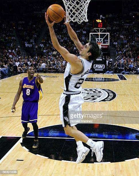 Guard Manu Ginobili of the San Antonio Spurs makes a reverse basket against Kobe Bryant of the Los Angeles Lakers on November 29 2005 at the SBC...
