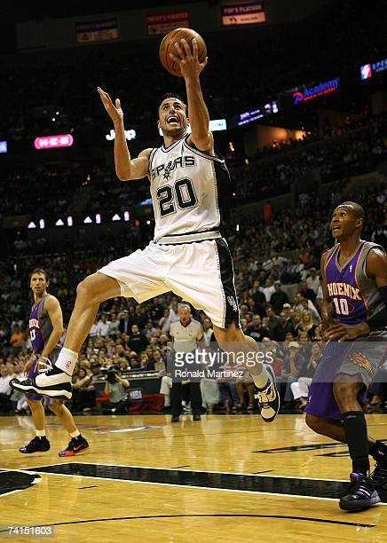 Guard Manu Ginobili of the San Antonio Spurs takes a shot against Leandro Barbosa of the Phoenix Suns in Game Four of the Western Conference...