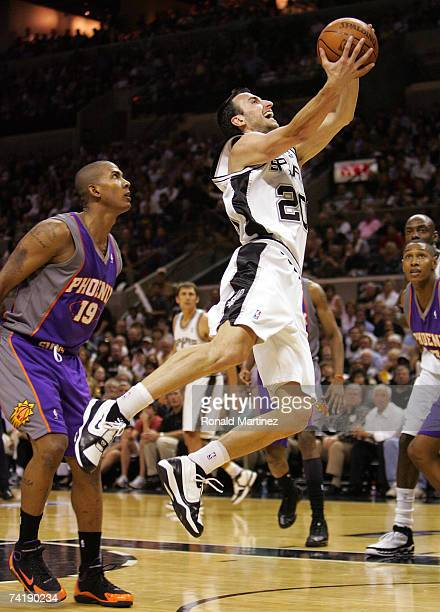 Guard Manu Ginobili of the San Antonio Spurs takes a shot against Raja Bell of the Phoenix Suns in Game Six of the Western Conference Semifinals...