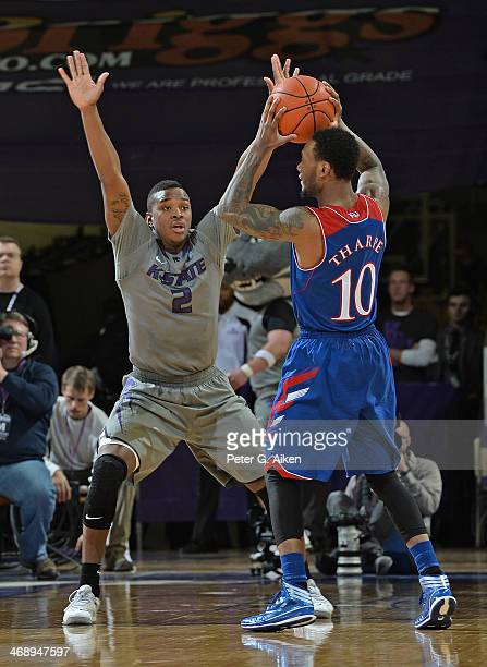 Guard Marcus Foster of the Kansas State Wildcats defends guard Naadir Tharpe of the Kansas Jayhawks during the second half on February 10 2014 at...