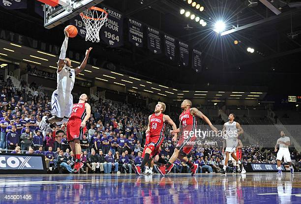 Guard Marcus Foster of the Kansas State Wildcats drives and scores past guard Casey Kasperbauer of the South Dakota Coyotes during the second half on...