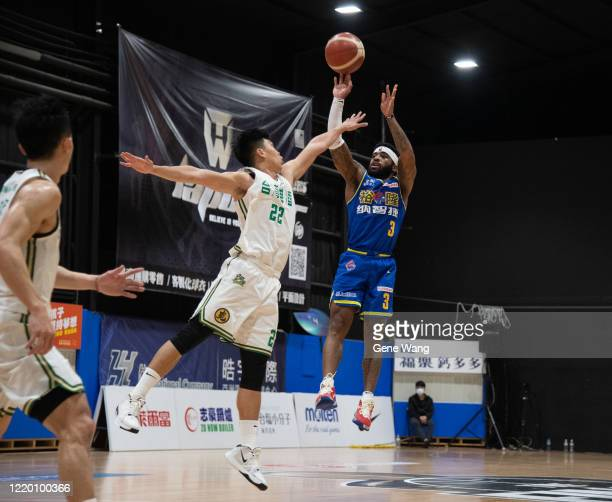 Guard Marcus Keene of Yulon Luxgen Dinos attempt to jump shot during the SBL Finals Game One between Taiwan Beer and Yulon Luxgen Dinos at Hao Yu...