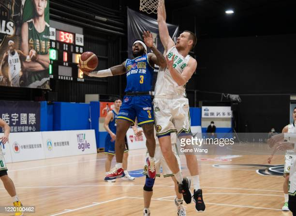Guard Marcus Keene of Yulon Luxgen Dinos attempt to layup during the SBL Finals Game One between Taiwan Beer and Yulon Luxgen Dinos at Hao Yu...