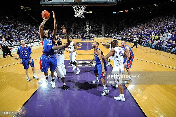 Guard Marcus Morris of the Kansas Jayhawks drives to the basket against pressure from forward Curtis Kelly of the Kansas State Wildcats in the second...
