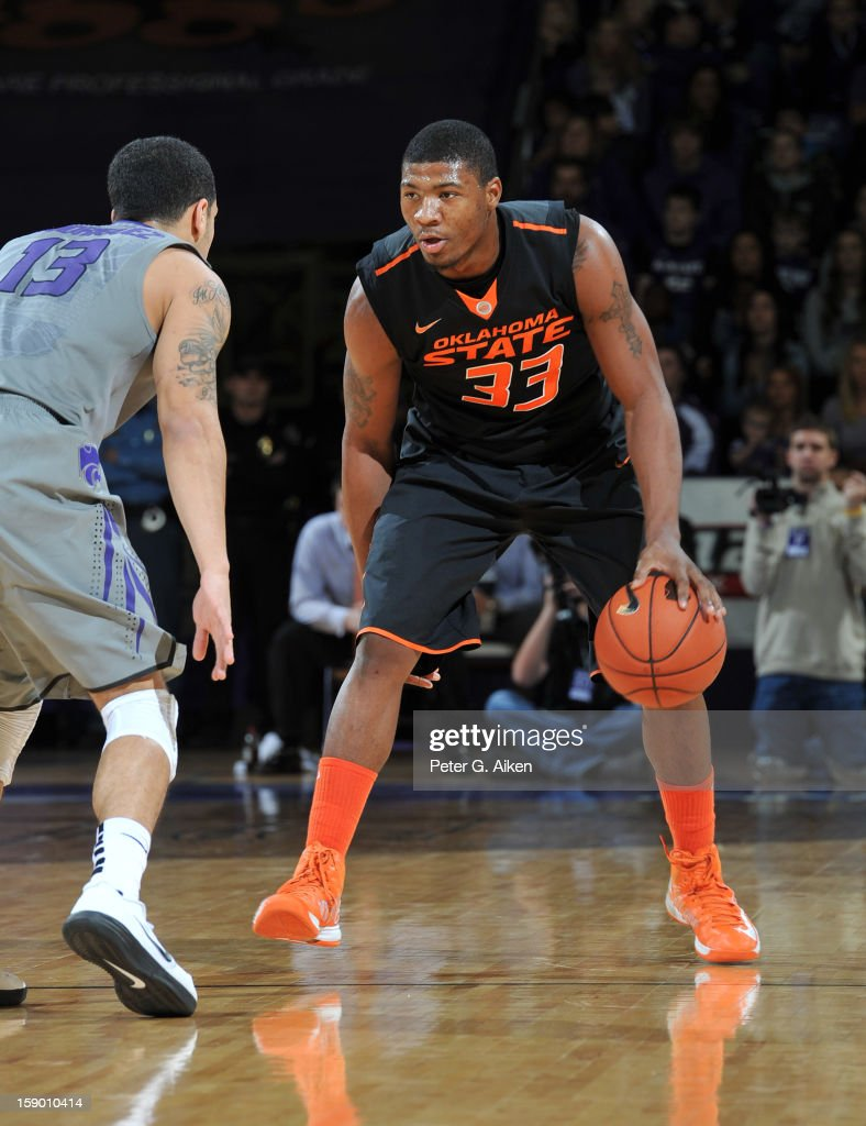 Guard Marcus Smart #33 of the Oklahoma State Cowboys brings the ball up court against guard Angel Rodriguez #13 of the Kansas State Wildcats during the first half on January 5, 2013 at Bramlage Coliseum in Manhattan, Kansas. Kansas State defeated Oklahoma State 73-67.