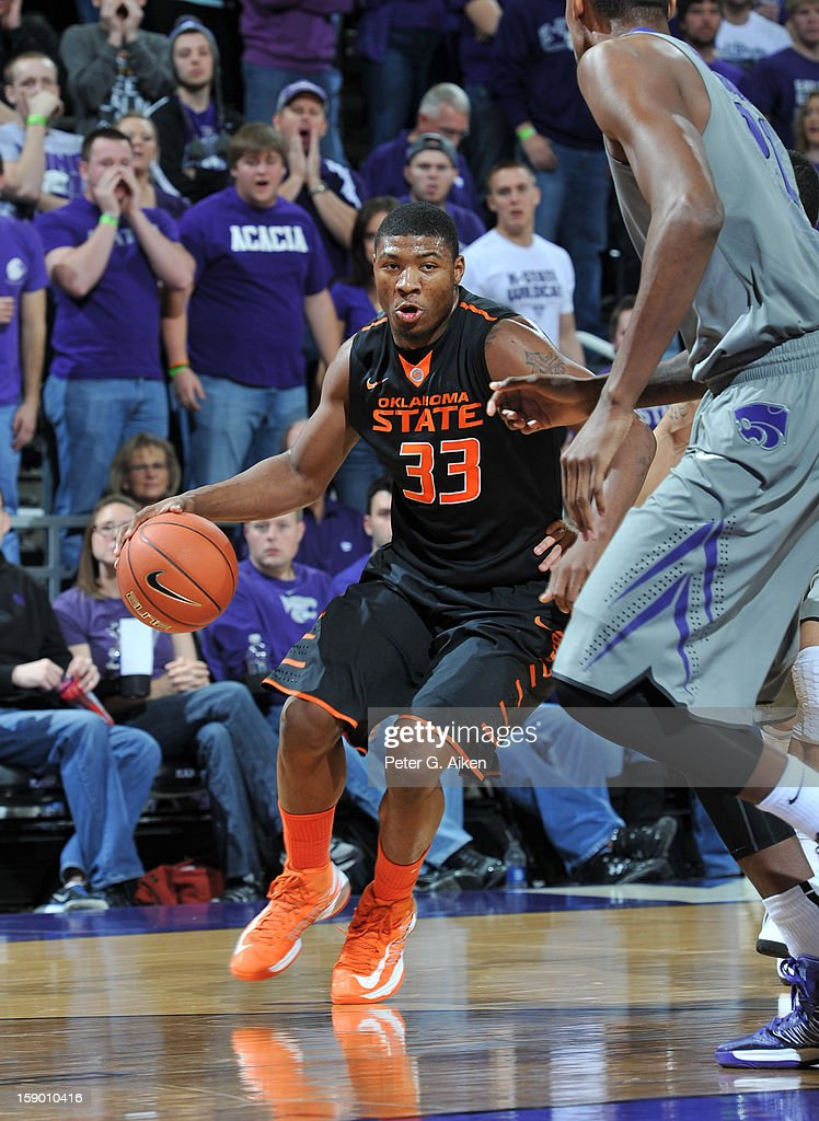 Guard Marcus Smart #33 of the Oklahoma State Cowboys brings the ball up court against the Kansas State Wildcats during the first half on January 5, 2013 at Bramlage Coliseum in Manhattan, Kansas. Kansas State defeated Oklahoma State 73-67.