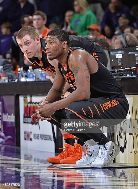 Guard Marcus Smart of the Oklahoma State Cowboys gets set to come back into the game with teammate Phil Forte against the Kansas State Wildcats...