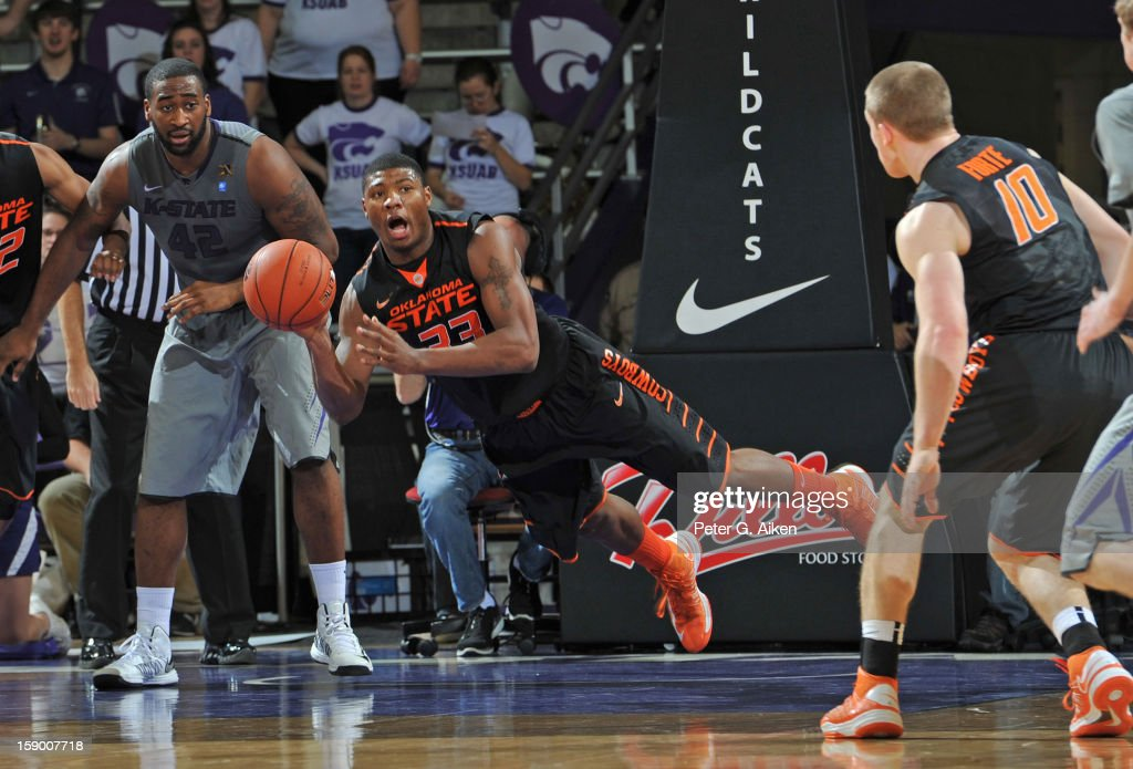 Guard Marcus Smart #33 of the Oklahoma State Cowboys makes a diving pass against the Kansas State Wildcats during the first half on January 5, 2013 at Bramlage Coliseum in Manhattan, Kansas.