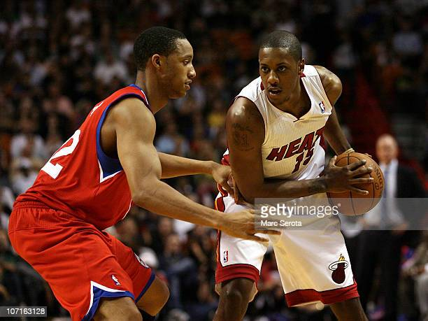 Guard Mario Chambers of the Miami Heat drives against Evan Turner the Philadelphia 76ers at American Airlines Arena on November 26 2010 in Miami...