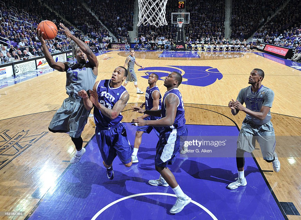 Guard Martavious Irving #3 of the Kansas State Wildcats drives to the basket against guard Garlon Green #33 of the Texas Christian Horned Frogs during the first half on March 5, 2013 at Bramlage Coliseum in Manhattan, Kansas. Kansas State defeated Texas Christian 79-68.