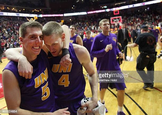 Guard Matt Bohannon and guard Paul Jesperson of the Northern Iowa Panthers celebrate after defeating the Iowa State Cyclones on December 19 2015...