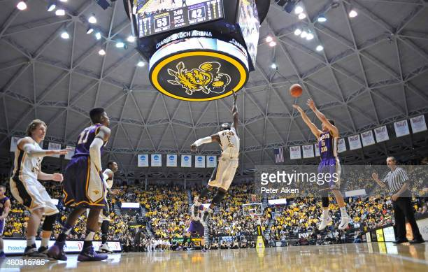 Guard Matt Bohannon of the Northern Iowa Panthers puts up a threepoint shot over forward Nick Wiggins of the Wichita State Shockers during the second...