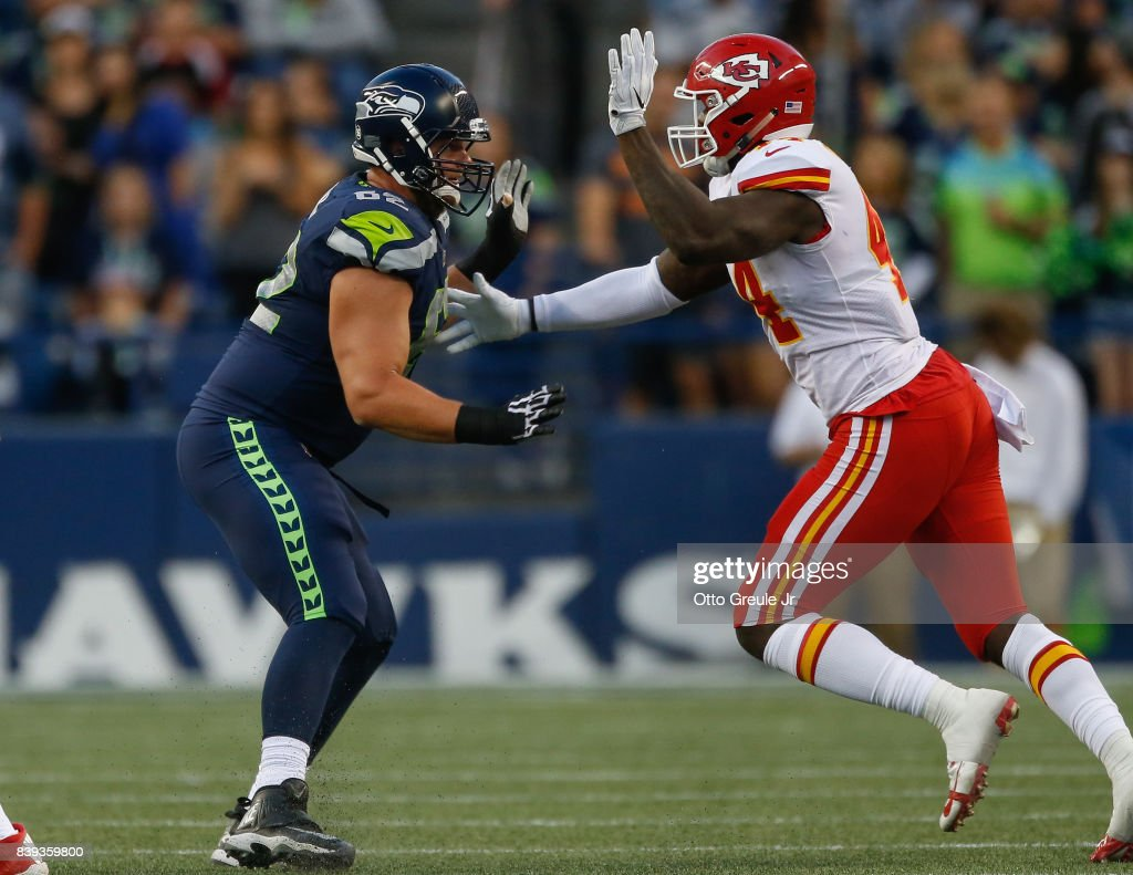 Guard Matt Tobin #62 of the Seattle Seahawks pass blocks against linebacker Earl Okine #44 of the Kansas City Chiefs at CenturyLink Field on August 25, 2017 in Seattle, Washington.