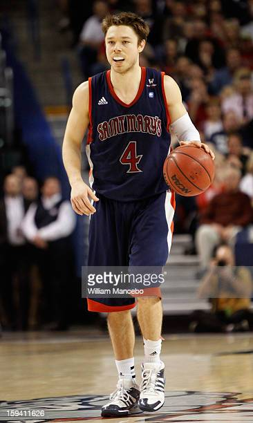 Guard Matthew Dellavedova of the Saint Mary's Gaels controls the ball during the game against the Gonzaga Bulldogs at McCarthey Athletic Center on...