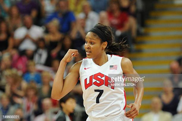US guard Maya Moore reacts after scoring during the women's quarter final basketball match USA vs Canada at the London 2012 Olympic Games on August 7...