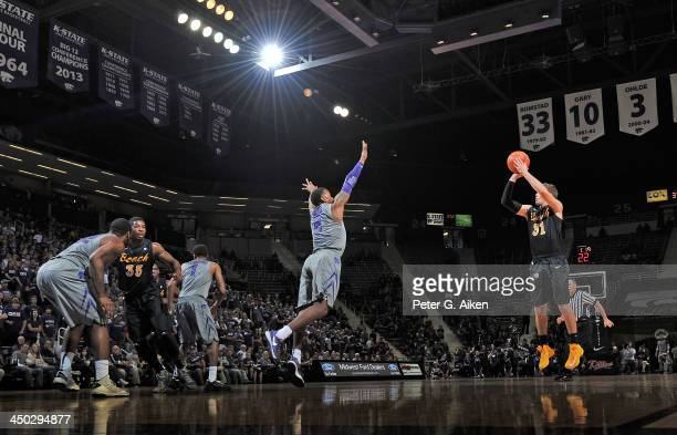 Guard McKay LaSalle of the Long Beach State 49ers puts up a shot against guard Marcus Foster of the Kansas State Wildcats during the first half on...
