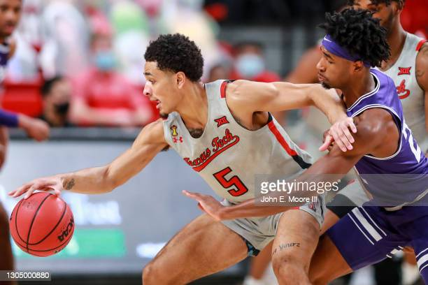 Guard Micah Peavy of the Texas Tech Red Raiders protects the ball against guard RJ Nembhard of the TCU Horned Frogs during the second half at United...