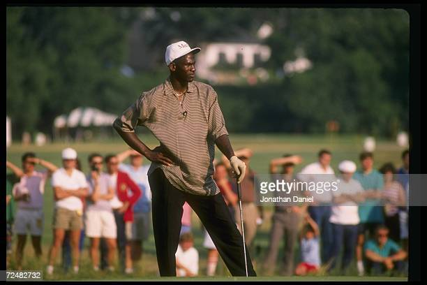 Guard Michael Jordan of the Chicago Bulls at a golfing event.