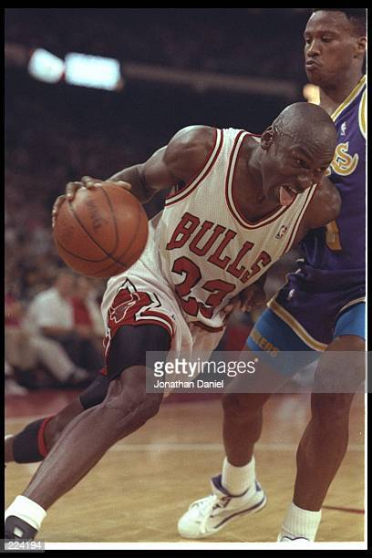 Guard Michael Jordan of the Chicago Bulls drives past Byron Scott of the Los Angeles Lakers during Game 1 of the 1991 NBA finals on June 2 1991 at...