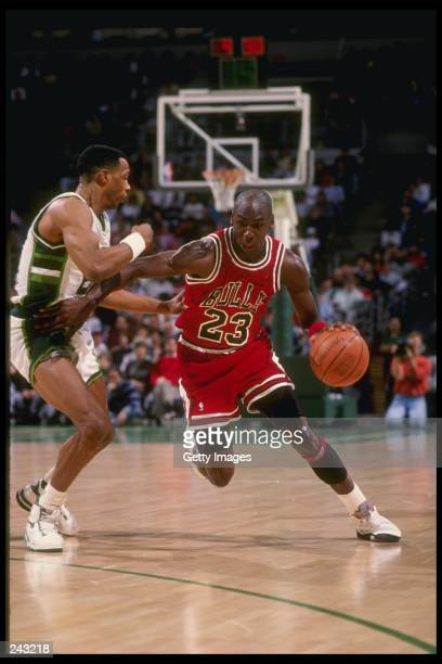 Guard Michael Jordan of the Chicago Bulls drives the ball down the court during a game against the Milwaukee Bucks at the Bradley Center in Milwaukee...