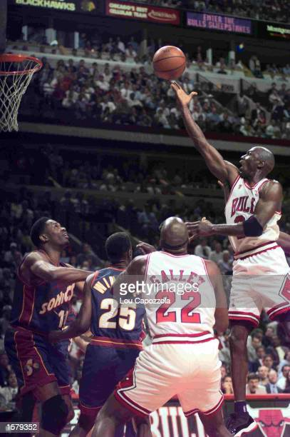 Guard Michael Jordan of the Chicago Bulls drives to the hoop during game 1 of the 1996 NBA Finals versus the Seattle Supersonics at the United Center...