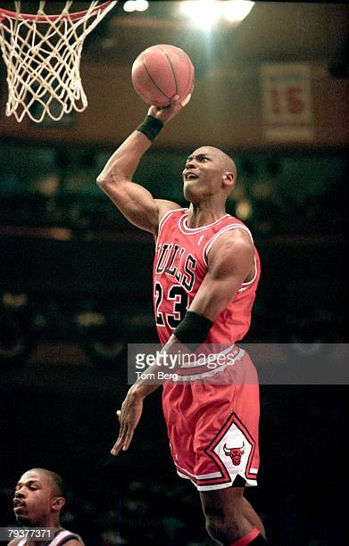 Guard Michael Jordan of the Chicago Bulls goes for a dunk during an NBA game against the New York Knicks circa 1990's at the Madison Square Garden in...