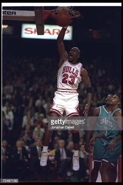 Guard Michael Jordan of the Chicago Bulls sinks the ball during a game against the Charlotte Hornets at the United Center in Chicago Illinois...