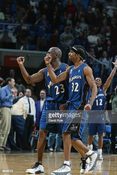 Guard Michael Jordan of the Washington Wizards and guard Richard Hamilton celebrate after Jordan hit the gamewinning shot at the end of the NBA game...