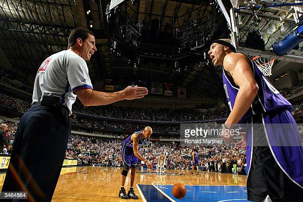 Guard Mike Bibby of the Sacramento Kings argues with official Tim Donaghy during play against the Dallas Mavericks in game three of the first round...