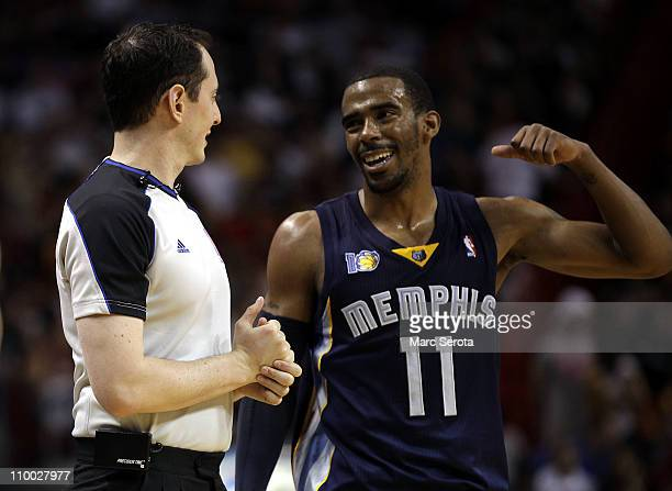 Guard Mike Conley of the Memphis Grizzlie chats with the referee against the Miami Heat at American Airlines Arena on March 12 2011 in Miami Florida...