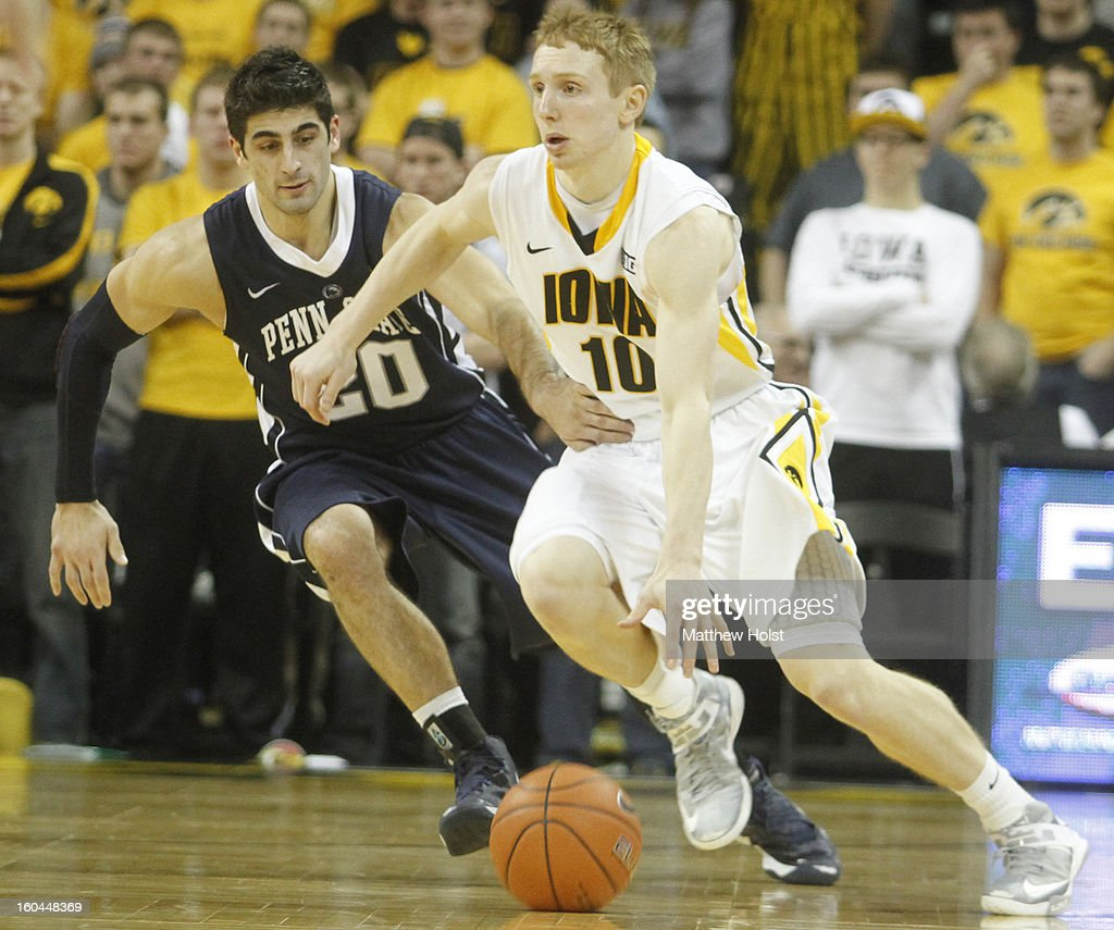 Guard Mike Gesell #10 of the Iowa Hawkeyes brings the ball down the court during the second half in front of guard Nick Colella #20 of the Penn State Nittany Lions on January 31, 2013 at Carver-Hawkeye Arena in Iowa City, Iowa.
