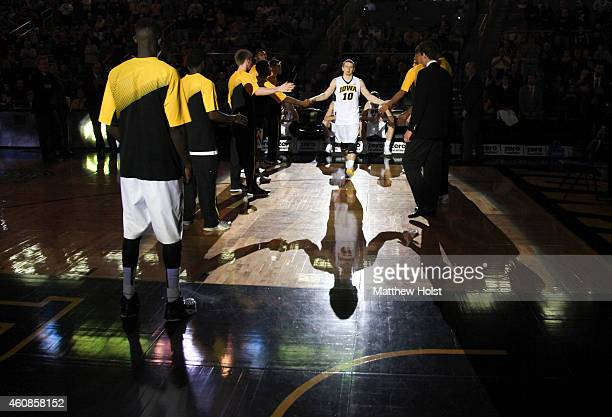 Guard Mike Gesell of the Iowa Hawkeyes is spotlighted during introductions before the match-up against the North Florida Ospreys, at Carver-Hawkeye...
