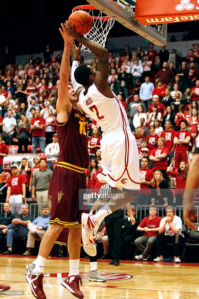 Guard Mike Ladd #2 of the Washington State Cougars goes to the basket against center Jordan Bachynski #13 of the Arizona State Sun Devils at Beasley Coliseum on January 31, 2013 in Pullman, Washington.