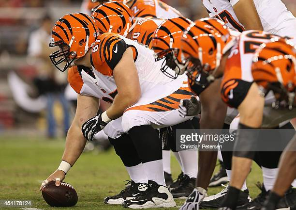 Guard Mike Pollak of the Cincinnati Bengals prepares to snap the football during the preseason NFL game against the Arizona Cardinals at the...
