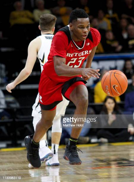 Guard Montz Mathis of the Rutgers Scarlet Knights steals the ball in the second half from guard Jordan Bohannon of the Iowa Hawkeyes on March 2 2019...