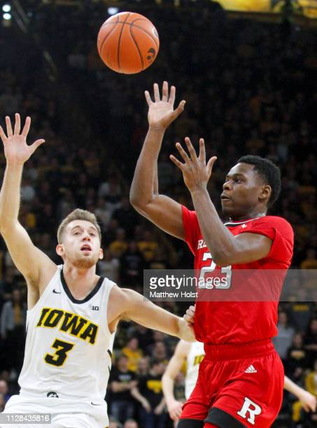 Guard Montz Mathis of the Rutgers Scarlet Knights takes a shot in the first half in front of guard Jordan Bohannon of the Iowa Hawkeyes on March 2...