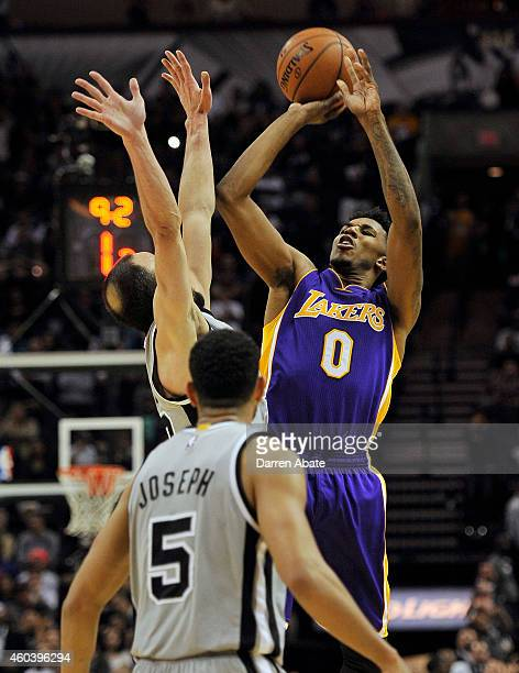 Guard Nick Young of the Los Angeles Lakers shoots the gamewinning shot against guard Manu Ginobili of the San Antonio Spurs during the overtime...