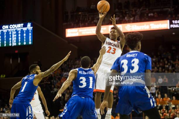 Guard Nigel Johnson of the University of Virginia Cavalier shoots the ball as he is defended by Forward Charles WilsonFisher of the Hampton...