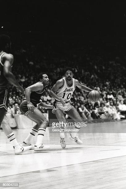 Guard Norm Nixon of the Los Angeles Lakers drives to the basket against Ron Boone of the Utah Stars during a National Basketball Association game at...