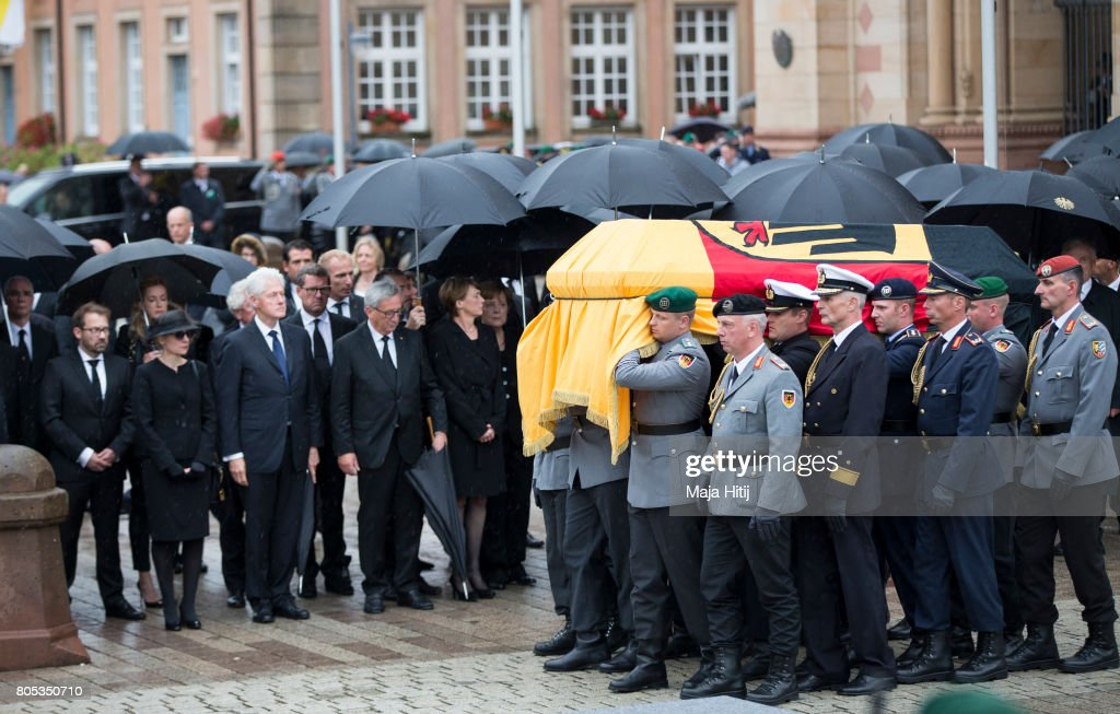 A guard of honor carries the coffin of former German Chancellor Helmut Kohl following a requiem at the Speyer cathedral on July 1, 2017 in Speyer, Germany. Kohl was chancellor of Germany for 16 years and led the country from the Cold War through to reunification. He died on June 16 at the age of 87.