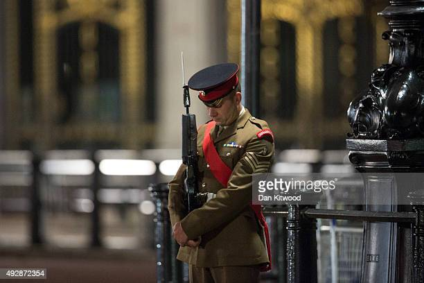 Guard of Honour comprising 96 rank and file and three officers from 1st Battalion Grenadier Guards with The Queen's Colour The Corps of Drums of the...